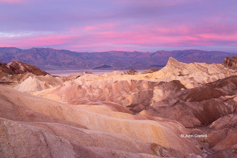 Death Valley National Park;Sunrise;Zabriskie Point, Clouds, Death Valley National Park, Desert, Desolation, Erosion, morning view, Mountains, Red Sky, Rock, Rocks, Sandstone, Sunrise, Zabriskie Point